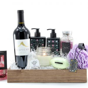 Luxurious spa gift basket with a bottle of wine