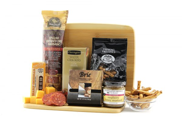 Assorted hearty and savory snacks delivered on a cutting board.