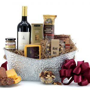 Gift basket delivered with a bottle of wine and classic happy hour snacks including cheese, meat, crackers, and more.