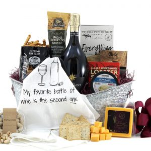 Generous gift basket with happy hour favorites such as crackers, cheeses, spreads, and more.