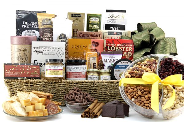 Large gift basket filled with a wide variety of cheeses, meats, chocolates, nuts, dips, and lots more!