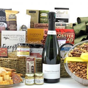 Large gourmet gift basket filled with a wide variety of sweet, salty, and savory snacks with a bottle of wine.