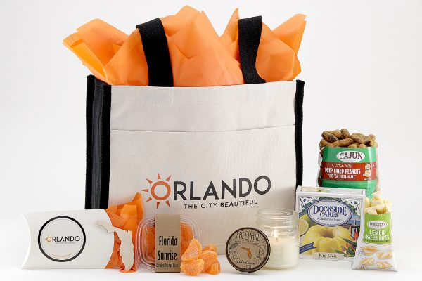 "Our exclusive tote bag with our beloved nickname - ""The City Beautiful."" Tote bag is filled with a variety of Florida souvenirs."