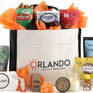 "Quality canvas tote bag with ""Orlando The City Beautiful"" printed on the front pocket and filled with a fantastic variety of Florida-made treats!"