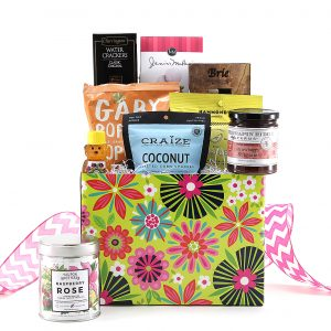Brightly colored floral print gift basket filled with a variety of treats including gourmet jam, local Florida honey, and so much more!