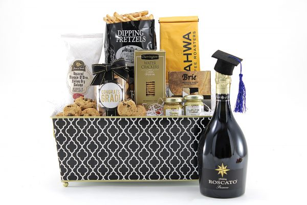 A Graduation themed gift basket with gourmet goodies and a bottle of Prosecco.