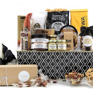 Gourmet gift basket with a graduation theme, filled with assorted sweet, salty, and savory treats!