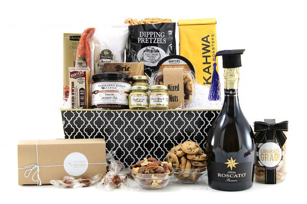 Variety of sweet & salty gourmet treats with a bottle of Italian Prosecco.