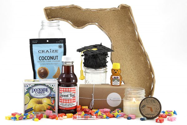 Graduation themed gift basket delivered in our famous Florida-shaped basket!