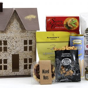 Housewarming gift filled with assorted gourmet treats including cheese, meat, crackers, cookies, candy, and more!
