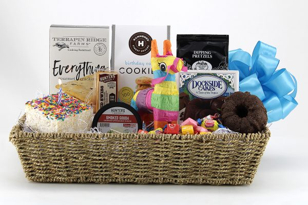 A fun birthday basket delivered with birthday staples, including a candy-filled piñata!
