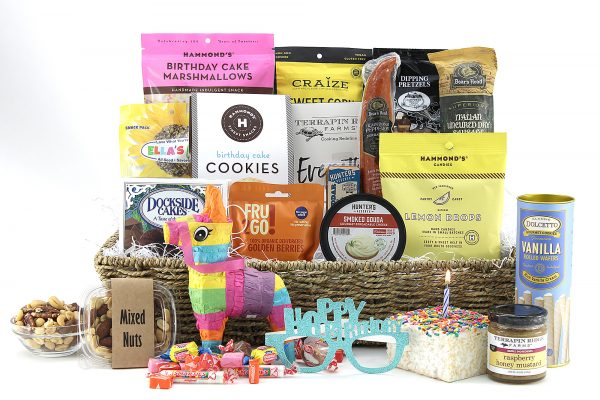 A fun birthday theme gift basket with birthday essentials including cake, cookies, candy, a piñata, and more surprises!