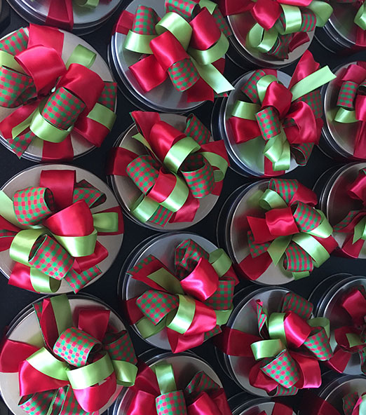 Gift basket with red and green ribbon
